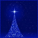 Blue Christmas background With Christmas tr. Square blue christmas card showing a Christmas tree made of shiny stars with a glowing tree top star and snowfall Royalty Free Stock Images