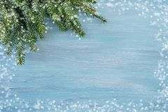 Blue Christmas background. Copy space, snow texture. Blue Christmas background with fir tree branch. Copy space, snow texture Royalty Free Stock Image