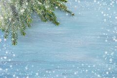 Blue Christmas background. Copy space, snow texture. Blue Christmas background with fir tree branch. Copy space, snow texture Royalty Free Stock Images