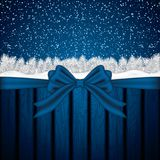 Blue Christmas background. With fir branches, bow and snow flakes.Vector illustration Stock Photography
