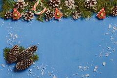 Blue christmas background with fir branches, cones, decor, snow, top view, copyspace stock images