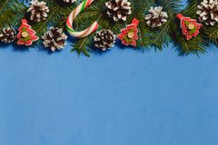 Blue christmas background with fir branches, cones, decor, top view, copyspace. royalty free stock photo