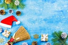 Blue Christmas background with fir branches, red giftboxes, silver and golden decorations, copy space stock image