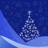 Blue Christmas background with fir tree. Abstract Christmas tree with sparkling snowflakes, stars, snow drifts, a snowfall on a blue background - festive Royalty Free Stock Images