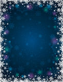 Blue christmas background with frame of snowflakes and stars stock image