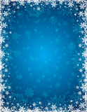 Blue christmas background with  frame of snowflakes and stars Royalty Free Stock Photos