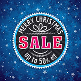 Blue christmas background and  label with sale offer Royalty Free Stock Photos