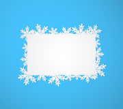 Blue Christmas background with paper snowflakes. Stock Image
