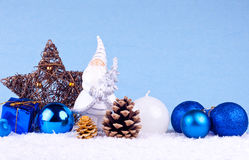 Blue christmas background with santa clause figure. Christmas decoration - santa claus figure on blue background stock images