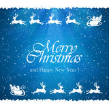 Blue Christmas background with Santa and reindeers Stock Photo