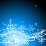 Blue Christmas background with snowflakes Stock Photos