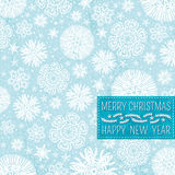 Blue christmas background with snowflakes and labe Stock Photos