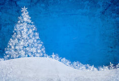 Blue christmas background. With snowflakes and pine tree Royalty Free Stock Image