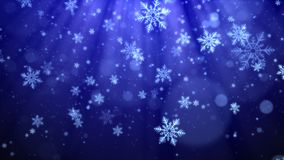 Blue Christmas background with snowflakes, shiny lights and particles bokeh in elegant theme.  Stock Photos
