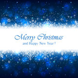Blue Christmas background with sparkle stars Royalty Free Stock Image