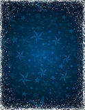 Blue christmas background with stars and frame of snowflakes stock photo
