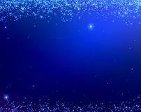 Blue Christmas background texture with stars falling from above. Royalty Free Stock Photos