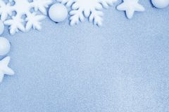 Blue christmas background. White christmas decoration on blue background royalty free stock photo