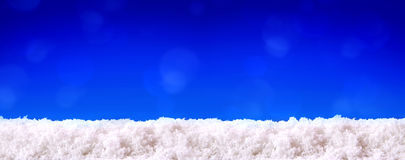 Blue  christmas background and white snow. Stock Image