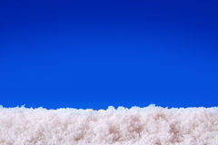 Blue  christmas background and white snow. Stock Photos