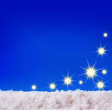 Blue christmas background and white snow. Royalty Free Stock Images
