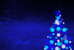 Blue christmas background. Witha christmas tree royalty free stock photos