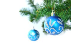 Blue christmas ball. Two blue christmas ball in a christmas tree Royalty Free Stock Images