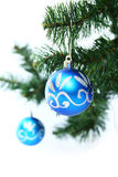 Blue christmas ball. Two blue christmas ball in a christmas tree Royalty Free Stock Photo