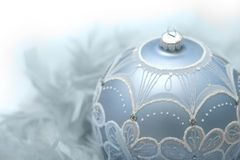 Blue christmas ball. On feathers with white background Royalty Free Stock Images
