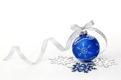 Blue christmas ball. With silver ribbon bow and snowflake on white background Stock Image