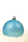 Blue christmas ball. On fur over white background Royalty Free Stock Image
