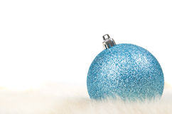 Blue christmas ball. On fur isolated on white Royalty Free Stock Images