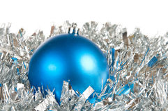 Blue christmas ball. Over silver tinsel Royalty Free Stock Photo