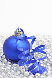Blue christmas ball. With a curly ribbon Stock Photo