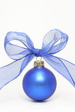 Blue christmas ball. With a blue ribbon on on a white background Royalty Free Stock Photography