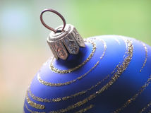 Blue Christmas ball. On green blurred background Stock Photo