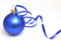 Blue christmas ball. With a curly ribbon Royalty Free Stock Photo