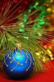 Blue christmas ball. On a colorful blue backgrpund Stock Photography