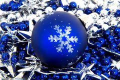 Blue christmas ball. On blue and white decoration pearl with stars Stock Photos