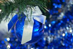 Blue christmas ball. With silver ribbon Stock Photo