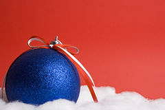 Blue christmas ball. Red background Royalty Free Stock Photo