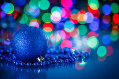 Blue Christmas ball. On a blue background Royalty Free Stock Photo