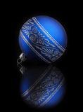 Blue Christmas ball on black background with reflection Stock Photo