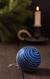 Blue christmas ball with candle and fir branch Stock Image