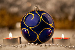 Blue Christmas ball and a candles Stock Photo