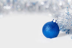 Blue Christmas ball with garland Stock Photo