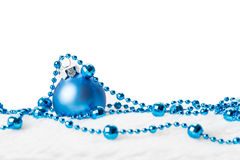 Blue Christmas ball with garland Royalty Free Stock Photography