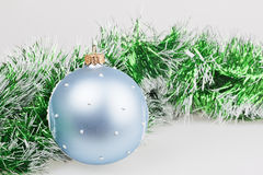 Blue Christmas ball with green garland Stock Photo