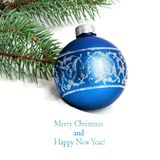 Blue Christmas ball and green spruce branch Royalty Free Stock Photos