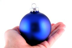 Blue Christmas Ball in Hand Stock Photos